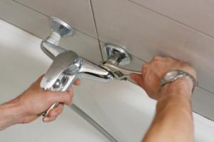 a service tech installs a Grohe faucet